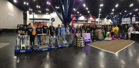 The teams lined up for a group photo with the robots.